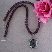 Amethyst Glass Beaded Necklace With An Opal Cabochon Pendant