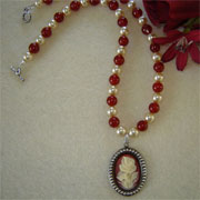 Vintage Style Cameo on a Beaded Necklace of Carnelian Gemstones and Smooth Glass Pearls