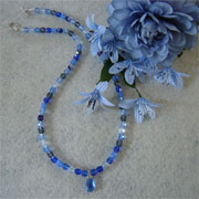 Shades of Blue and Gray Glass Beaded Necklace with a Teardrop Pendant