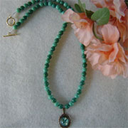 Green Glass Beaded Necklace With A Green Opal Cabochon Pendant