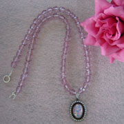 Light Cranberry Glass Beaded Necklace With an Opal Cabochon Pendant