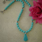 Turquoise Glass Beaded Necklace with Carved Butterfly Pendant