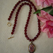 Garnet Beaded Necklace With An Opal Cabochon Pendant