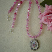 Floral Cameo On A Pink Glass Beaded Necklace