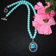 Turquoise Glass Beaded Necklace With A Blue Paua Shell Cabochon