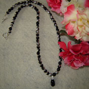 Black and Silver Glass Beaded Necklace With A Black Teardrop Pendant