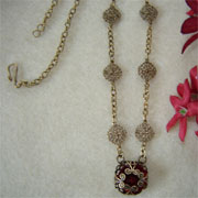 Filigree Necklace With A Wrapped Ruby Glass Round Stone