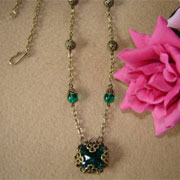 Filigree Necklace With A Wrapped Emerald Glass Round Stone