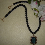 Montana Blue Glass Beaded Necklace With A Glass Oval Stone Pendant