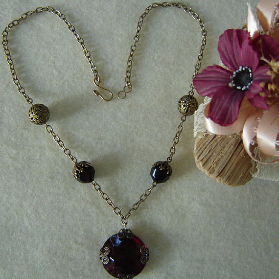 Filigree Necklace With A Wrapped Round Ruby Glass Pendant