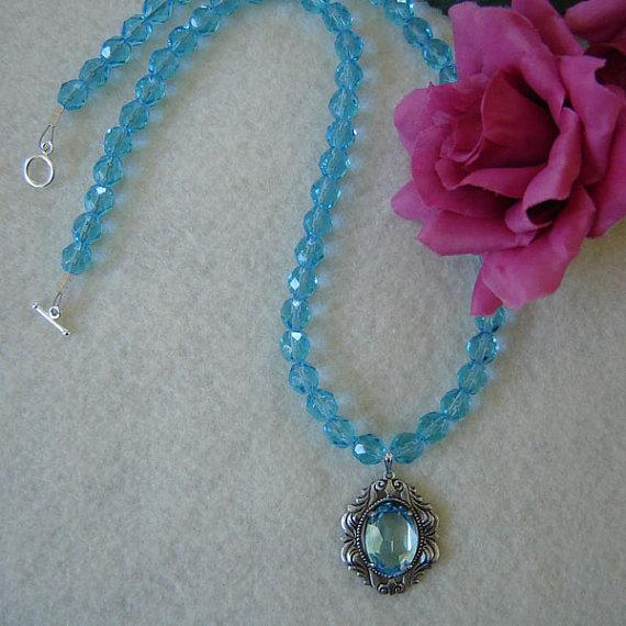 Aquamarine Glass Beaded Necklace With A Swarovski Oval Stone Pendant