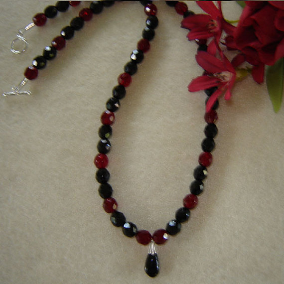 Jet Black And Garnet Glass Beaded Necklace With A Teardrop Pendant